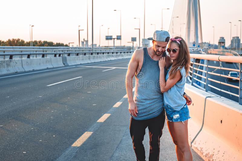 Couple in love standing on the street stock photography