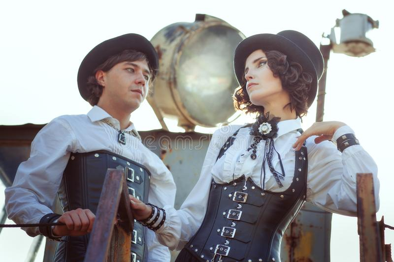 Couple in love in the style of steampunk stock photos