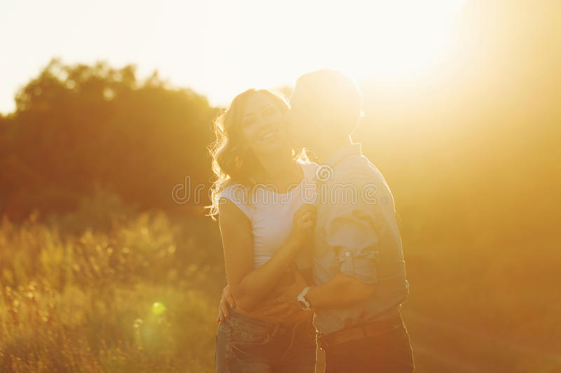 Couple in love at sunset. Kiss royalty free stock images