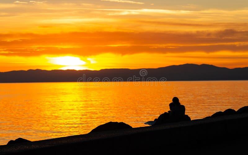 Couple. Love. Sunset. Lake. Color. Silhouette stock photo