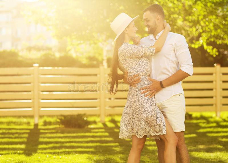 couple in love at sunset walking in the park happy, American dream. The concept of family values. stock image