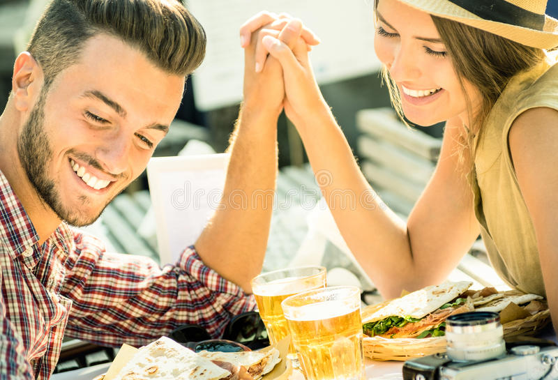 Couple in love taking selfie at beer restaurant royalty free stock photos