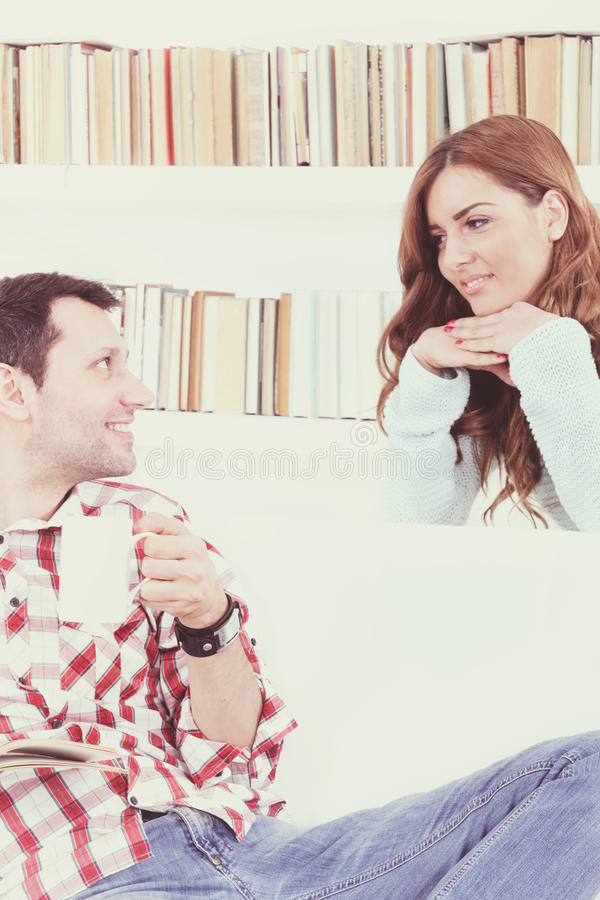 Couple in love talking and listening to each other. Carefully, happy couple in domestic atmosphere royalty free stock photo