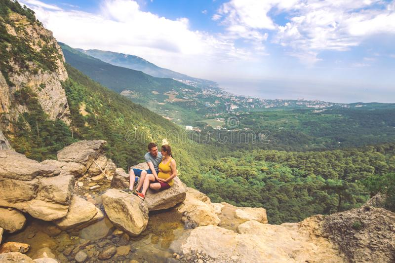 Couple in love travel photo in mountains. stock photography