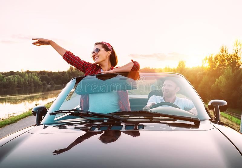 Couple in love traveling by cabriolet royalty free stock image