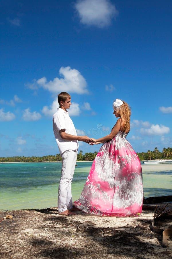 Couple in love on tropical beach stock photos