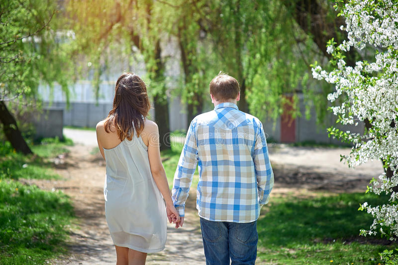 Couple in love walking along the path stock image