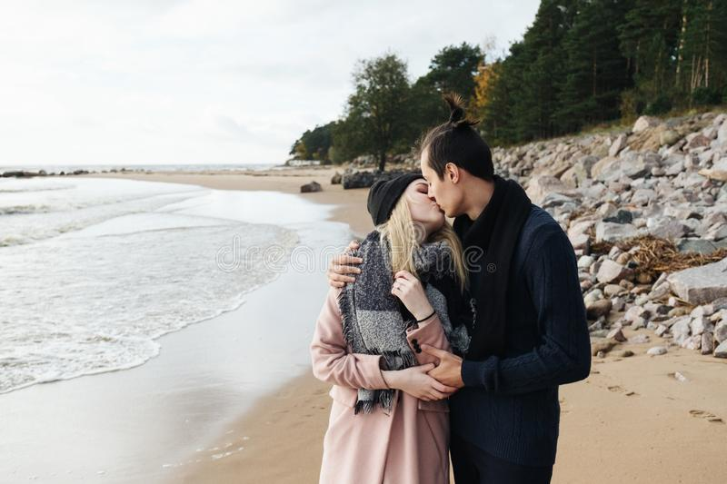 Couple in love walking on the beach, hugging and kissing. royalty free stock images