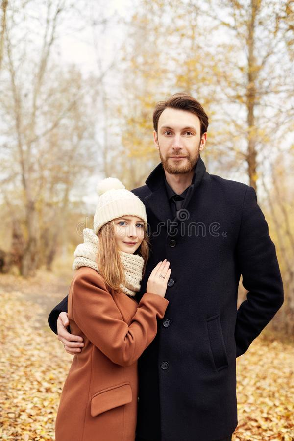 Couple in love walking in the Park, Valentine`s day. A man and a woman embrace and kiss, a couple in love, tender feelings royalty free stock photos