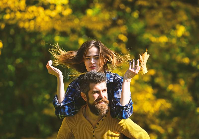 Couple in love walks in park. Girl and bearded guy stock photo