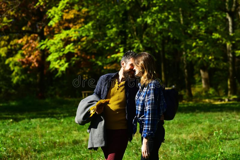 Couple in love walks in park. Man and woman royalty free stock photography