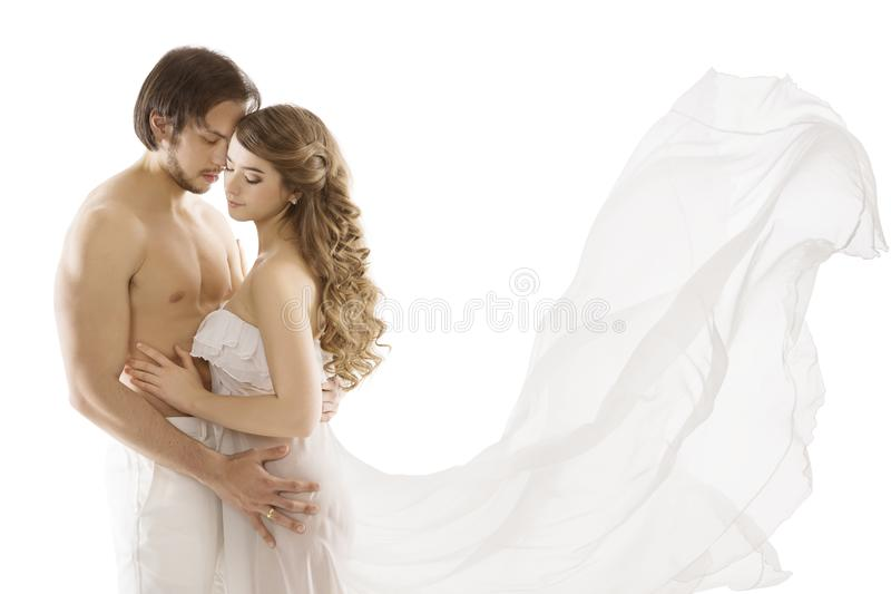 Couple in Love, Young Man Kissing Woman, Waving Dress. Couple in Love, Young Man Kissing Romantic Woman, Waving Dress over White Background royalty free stock photos