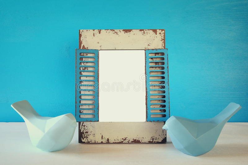 Couple of Lovebirds and blank photo frame royalty free stock photography