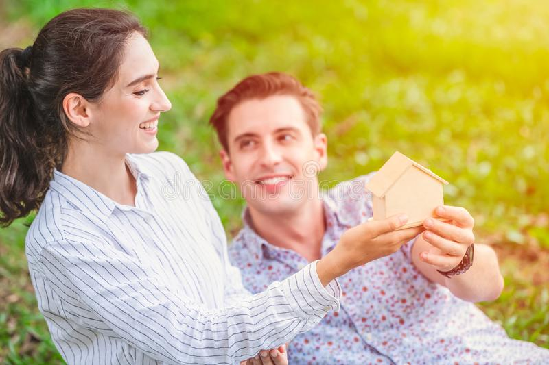 Couple lover hand holding home dummy for plan to buying new house for marriage property and living together after married concept stock images