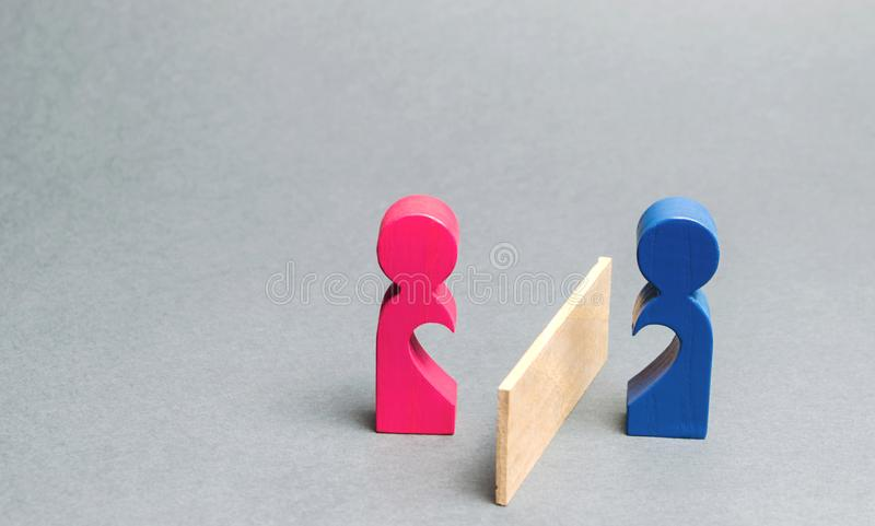A couple of lovers divided barrier. Concept of breaking relationships, parting and quarrel. Family psychologist services. Divorce. And division of property stock image
