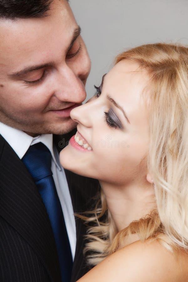 Couple of lovers groom and bride studio shot. Wedding day. Romantic couple of lovers groom and bride. Studio shot gray background stock photo