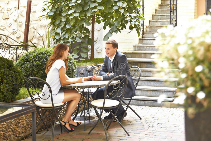Couple of lovers having dinner in restaurant handsome man in stylish business suit beautiful woman in fashionable dress sitting i stock image