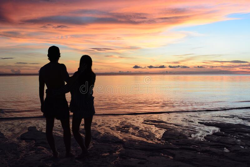 Couple of lovers staring at the sunset. White beach. Boracay. Western Visayas. Philippines stock images