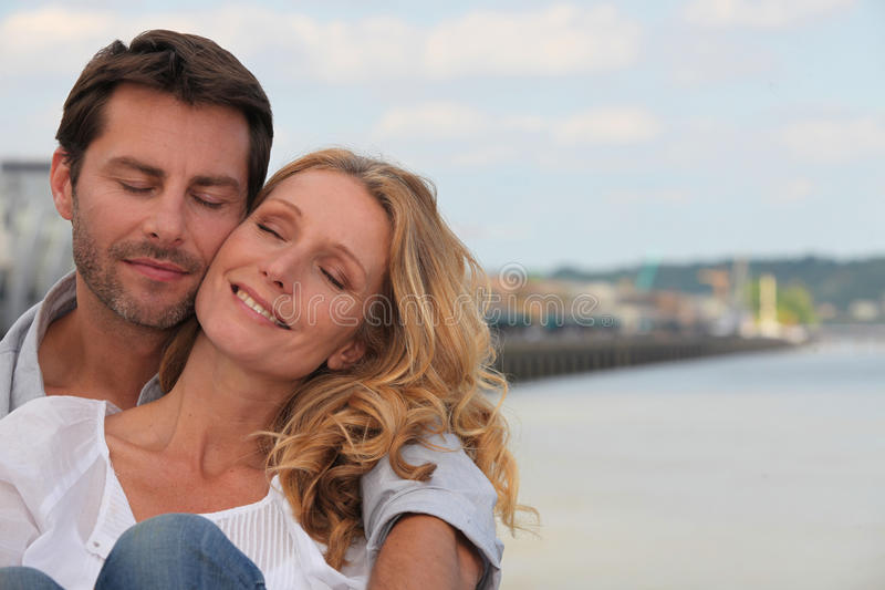 Couple in a loving embrace. On the waterfront of Bordeaux stock photo