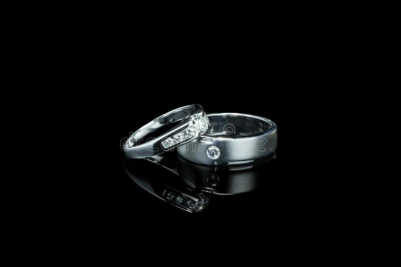 Couple of luxury wedding diamond rings for bride and groom stock images