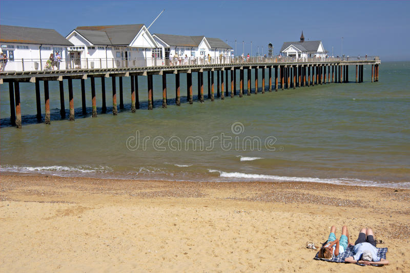 Download Couple Lying On Beach, England Editorial Stock Image - Image: 15255459