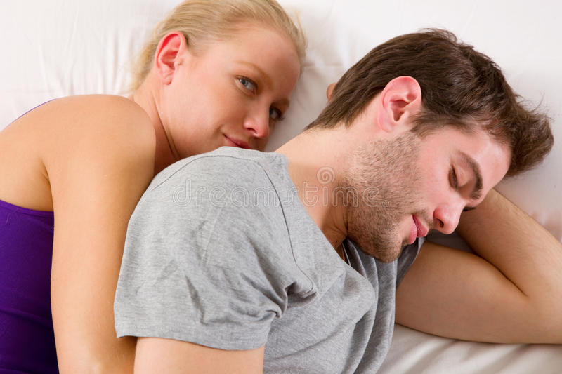 Couple Lying In Bed Stock Photos