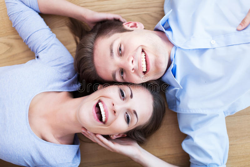 Download Couple lying on the floor stock photo. Image of indoors - 32023684