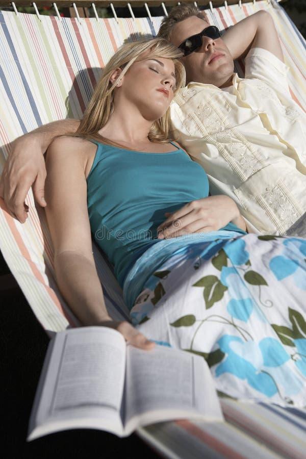 Couple Lying On Hammock stock images