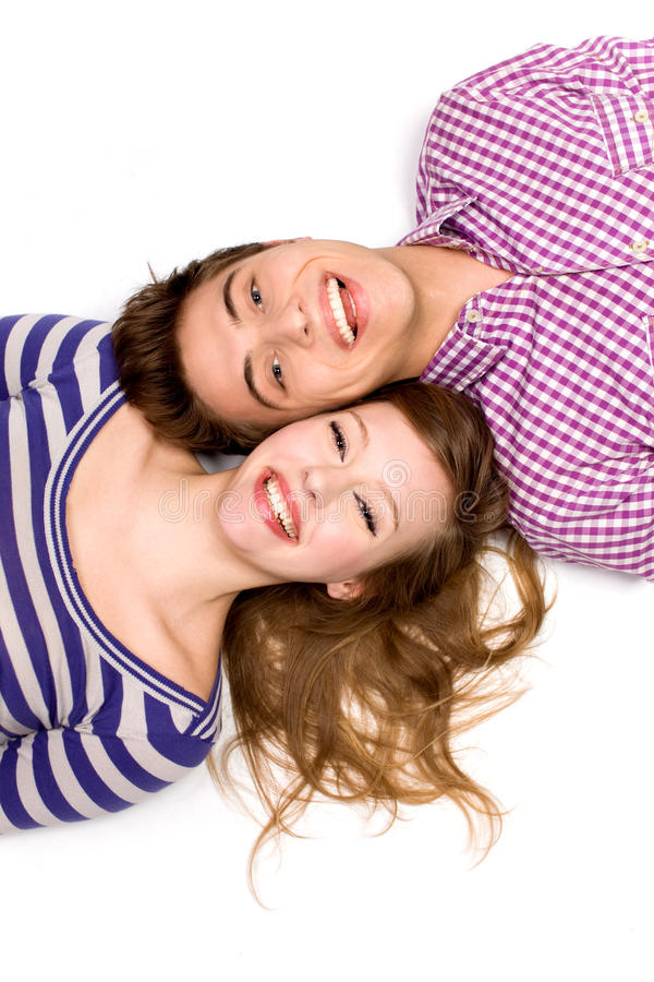 Couple lying head to head royalty free stock images