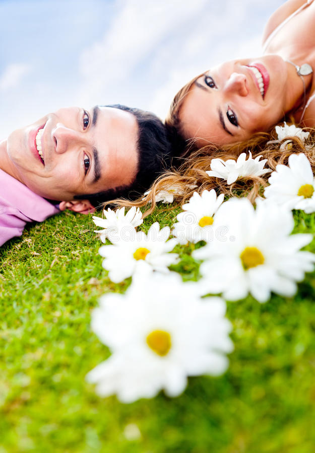 Download Couple lying outdoors stock photo. Image of floral, female - 23428880