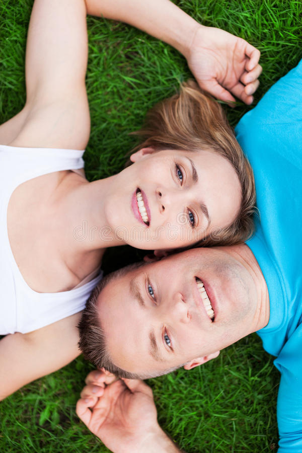 Couple lying together head to head royalty free stock photos