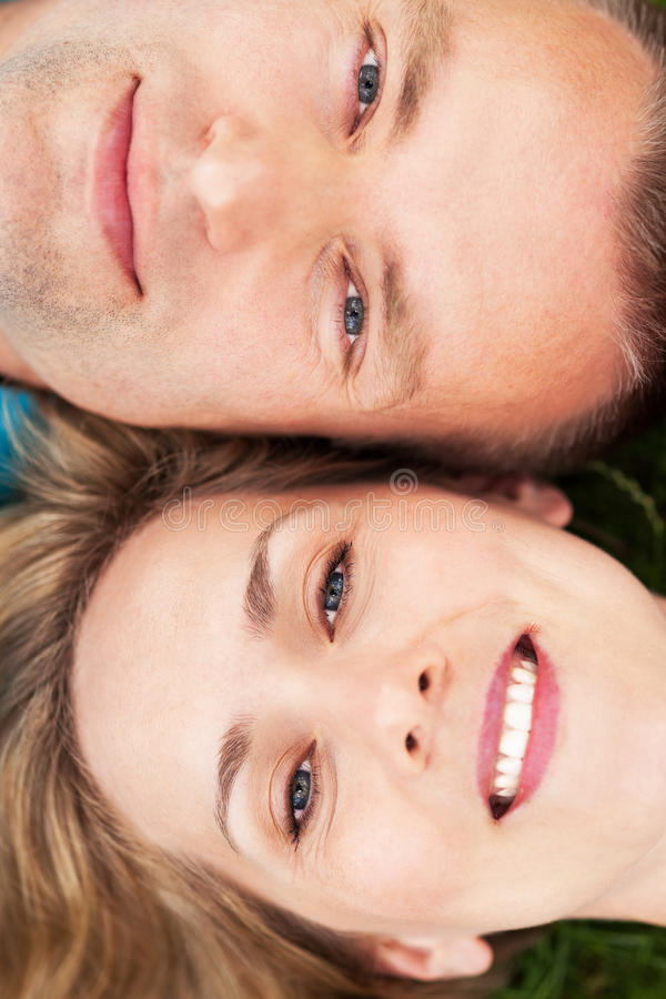 Couple lying together head to head royalty free stock images