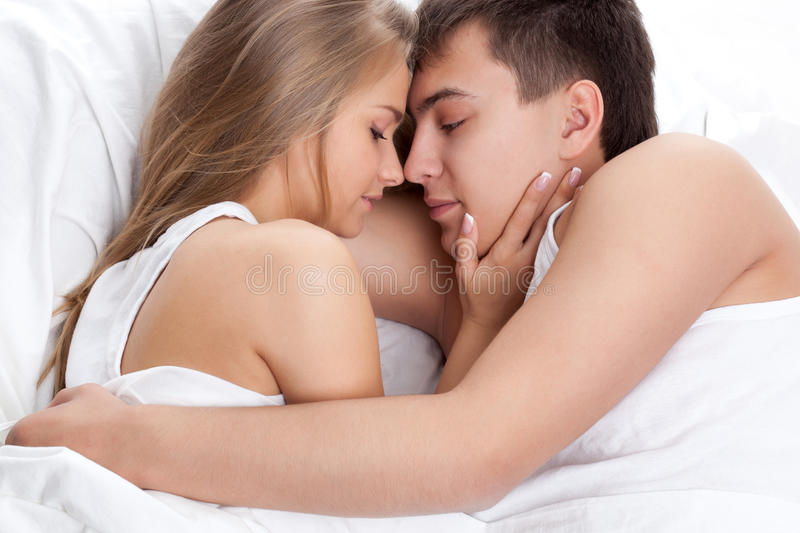 Download Couple lying on white bed stock image. Image of happy - 20499495