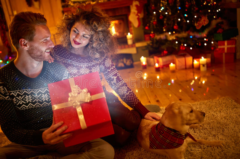 Couple with magical gift for Christmas stock photography