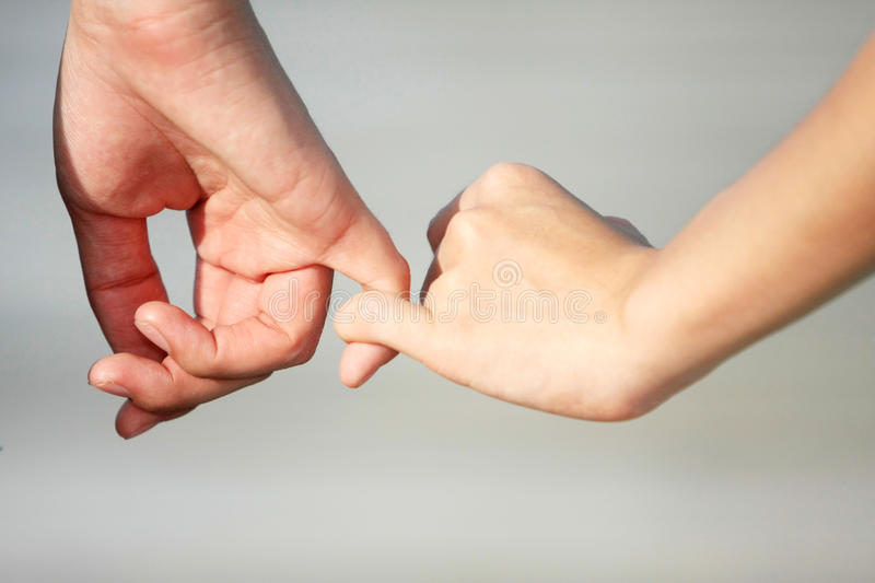 A couple make a hand on hand with love stock image