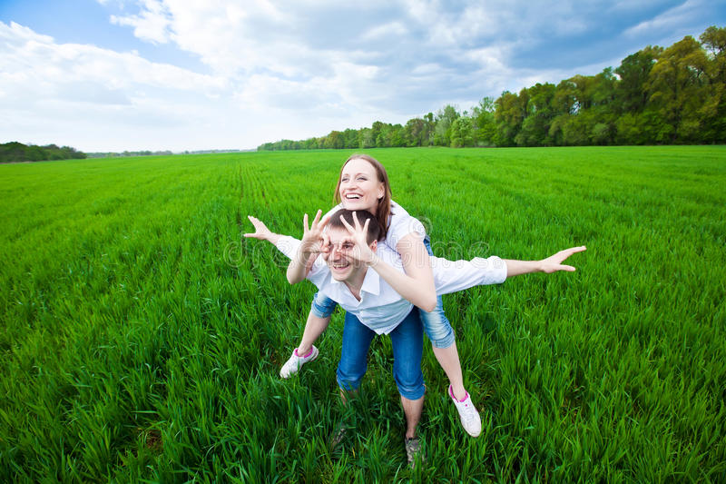 Couple making an airplane in the field royalty free stock image