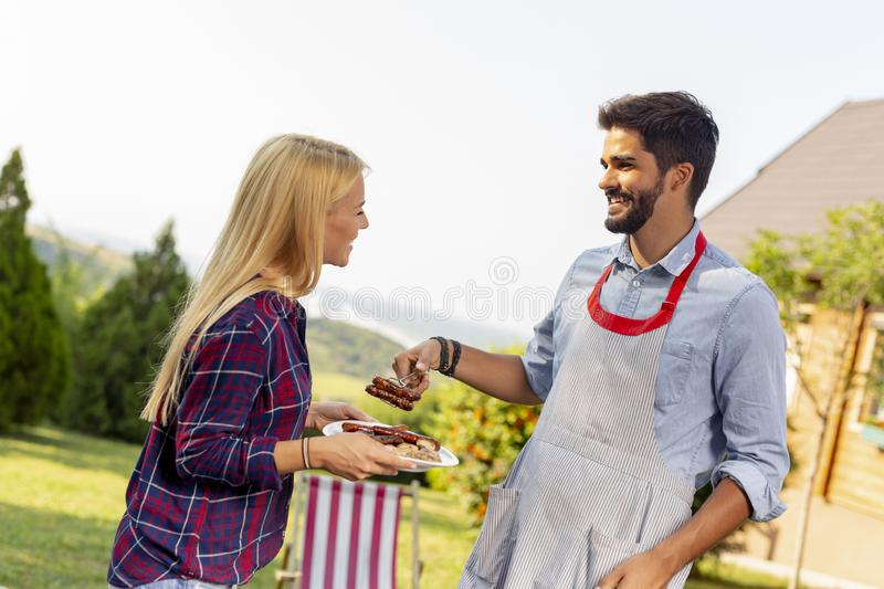 Couple making barbecue stock photo