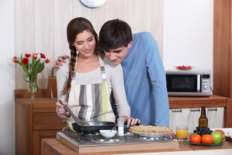 Download A Couple Making Crepes. Royalty Free Stock Photos - Image: 26496028