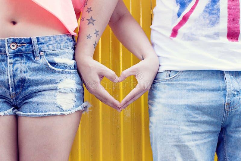 Couple making heart shape stock images