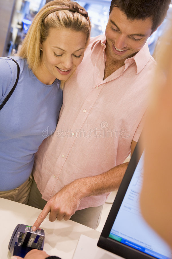 Download Couple Making Purchase In Store Stock Photo - Image: 5093080