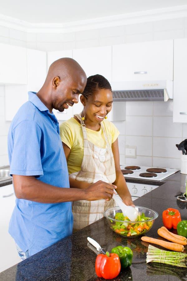 Couple Making Salad Stock Photography