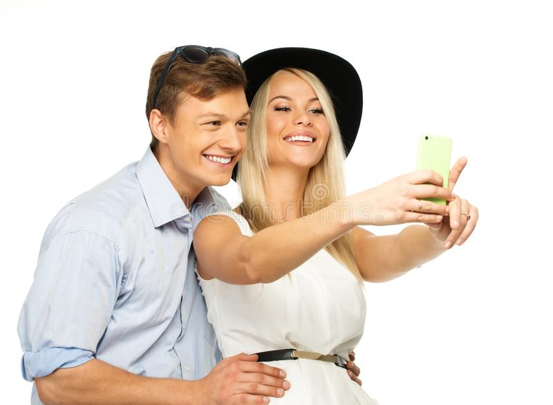 Couple making selfie. Beautiful smiling young couple making selfie stock photo