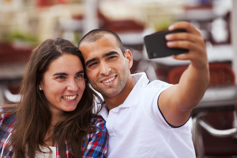 Couple making selfies stock photo