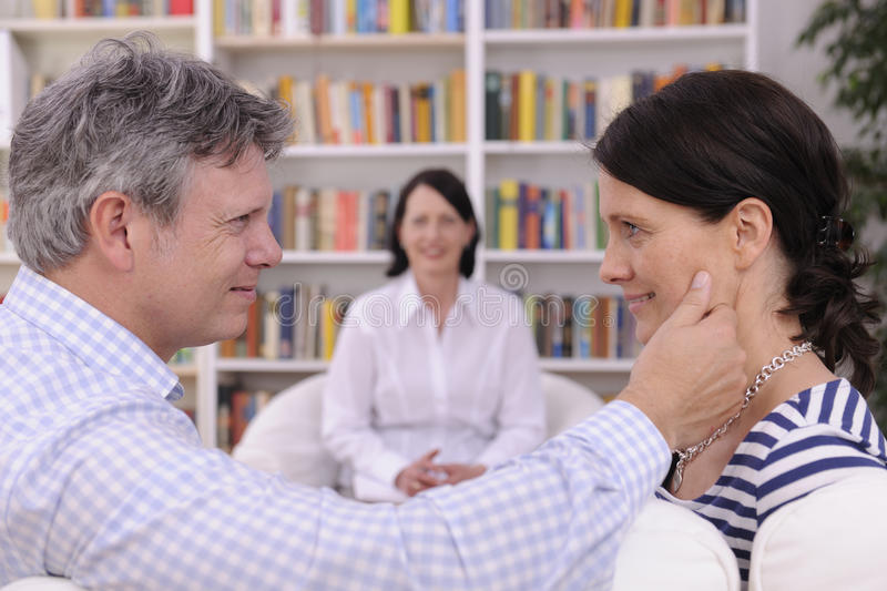 Couple making up at therapy session royalty free stock photo