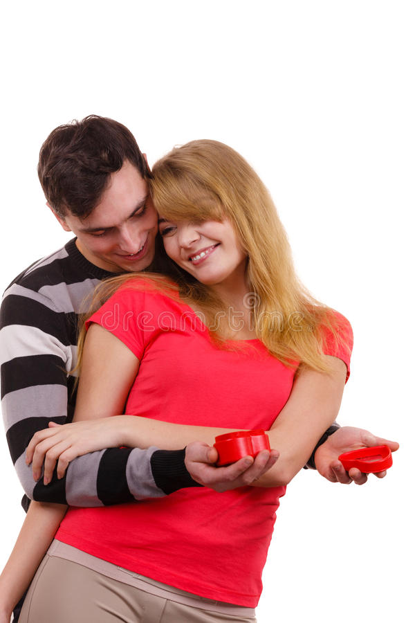 Couple. Man surprising cheerful woman with gift box. Couple and holiday concept. Handsome men surprising cheerful women with red heart shaped gift box isolated royalty free stock photos