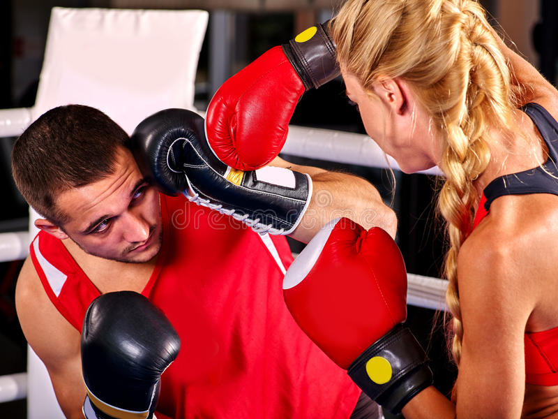 Couple Man and Woman Boxing in Ring. royalty free stock photos