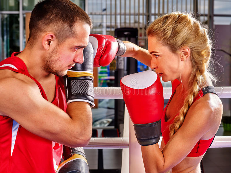 Couple Man and Woman Boxing in Ring. royalty free stock images
