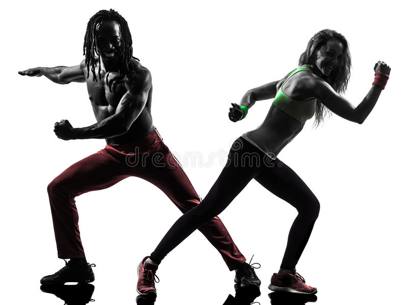 Couple man and woman exercising fitness zumba dancing silhouette royalty free stock image