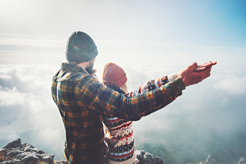 Couple Man and Woman holding hands raised on mountain summit. Love and Travel happy emotions feelings Lifestyle concept. Young family traveling active adventure royalty free stock photos