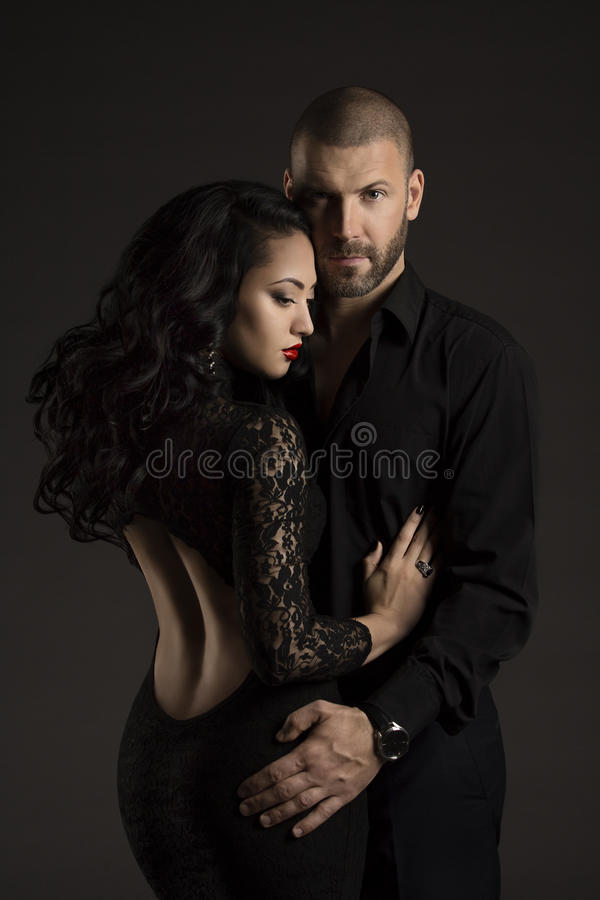 Couple Man and Woman in Love, Fashion Beauty Portrait of Models. Embracing over Black Background royalty free stock photography